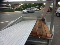 Collecting the hardwood and tin from the recycled building supplies place
