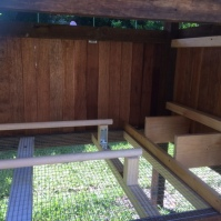 Inside showing the mesh floor, nesting boxes and perches